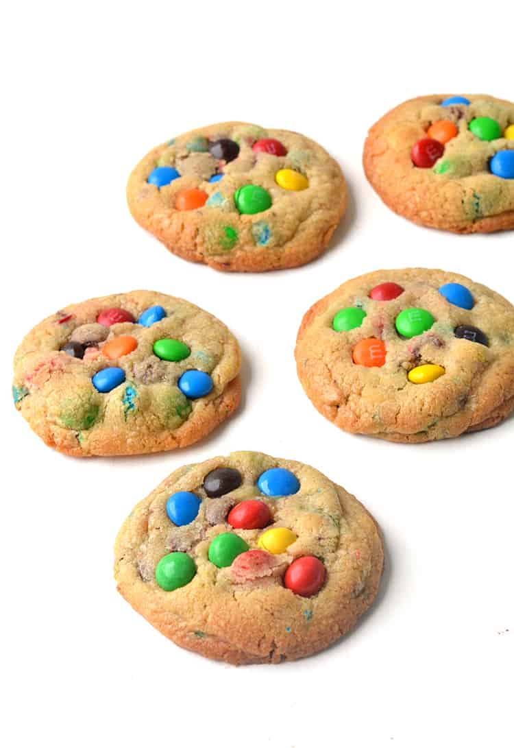 Colourful M&M cookies on a white background