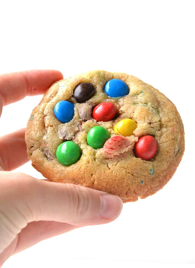 Hand holding an M&M cookie