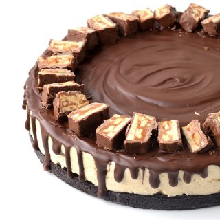 Peanut Butter Snickers Oreo Cheesecake