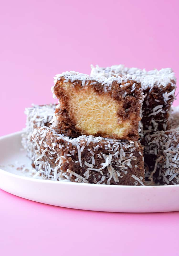 A plate of homemade lamingtons on a white plate
