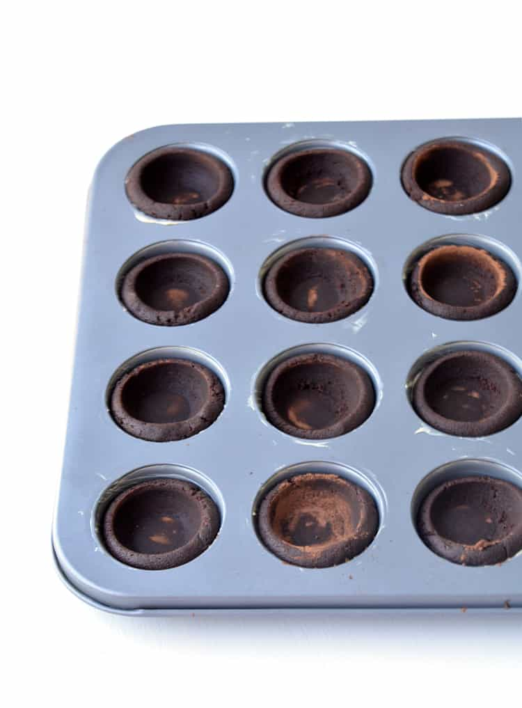 Chocolate cookie cups in a mini muffin pan