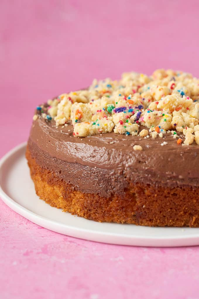 Yellow cake with chocolate frosting and funfetti cookie crumbs