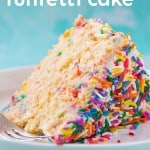 A slice of funfetti cake on a white plate