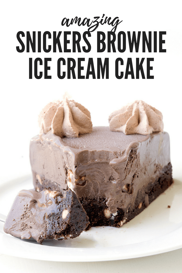 The BEST cake ever! Fudgy chocolate brownie topped with creamy chocolate ice-cream and lots of Snickers bars! Recipe from sweetestmenu.com #dessert #snickers #icecream #cake