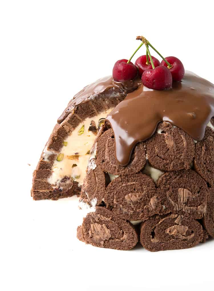 Chocolate Ice Cream Pudding Bombe topped with fresh cherries