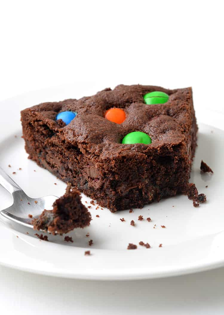 M&M Chocolate Cookie Cake with a bite taken out of it