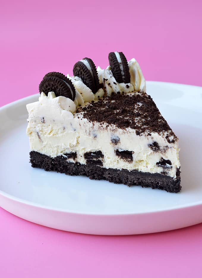 A slice of No Bake Oreo Cheesecake on a white plate