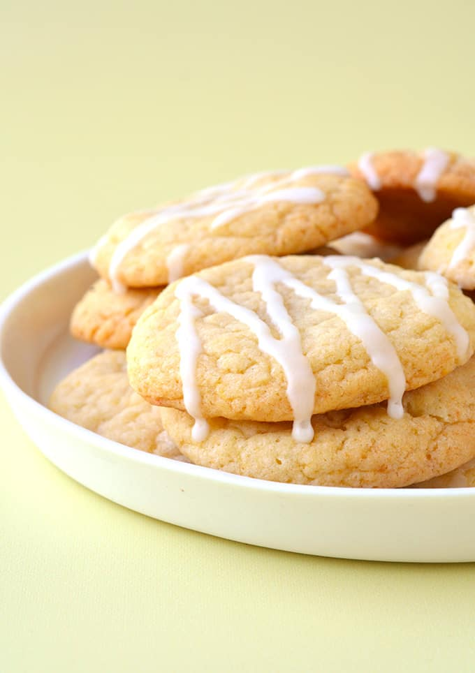 A pile of Lemon Cookies on a white plate