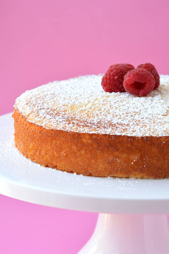 Lemon Ricotta Cake topped with fresh raspberries