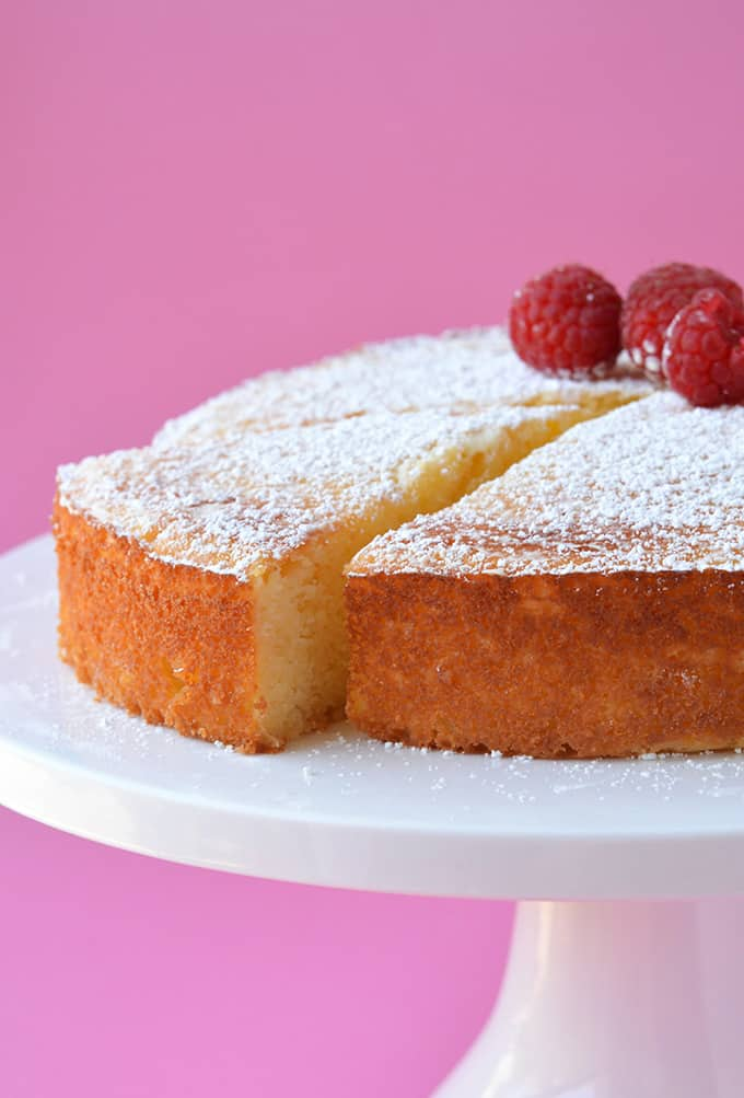 Lemon Ricotta Cake with a slice taken out of it