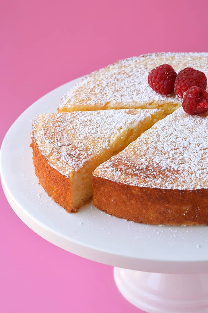 Top view of a Lemon Ricotta Cake with a slice cut