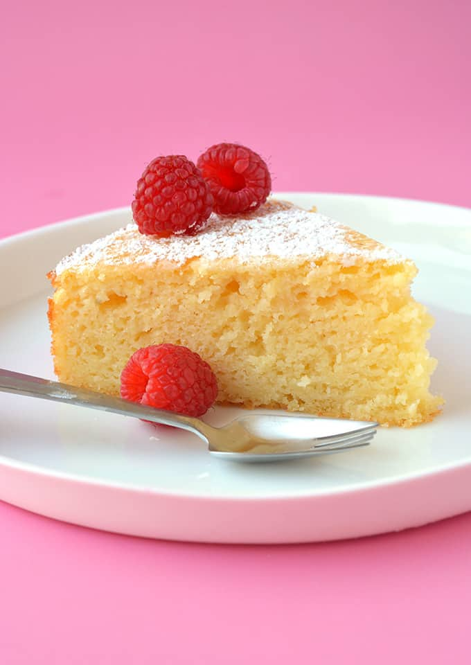 A slice of Lemon Ricotta Cake on a white plate