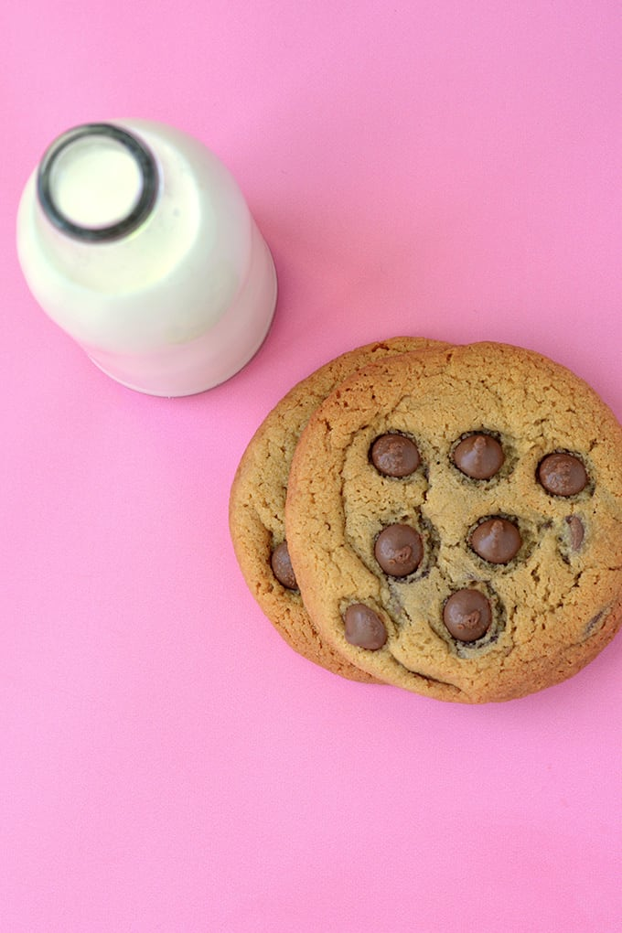 Top view of a Malted Chocolate Chip Cookies and a glass of milk