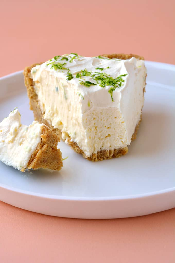 A slice of No Bake Key Lime Pie with a bite taken out of