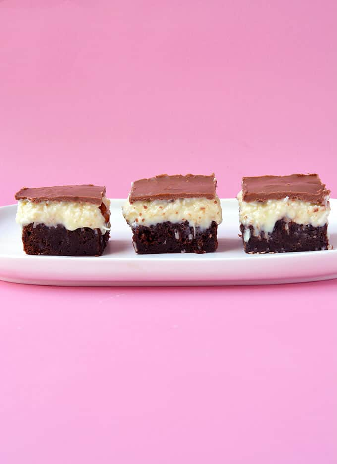 Three fudgy Almond Joy Brownies sitting in a row