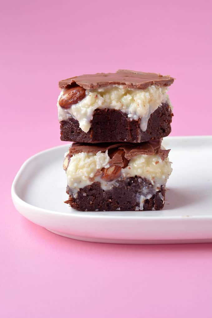 An Almond Joy Coconut Brownies with a bite taken out of it