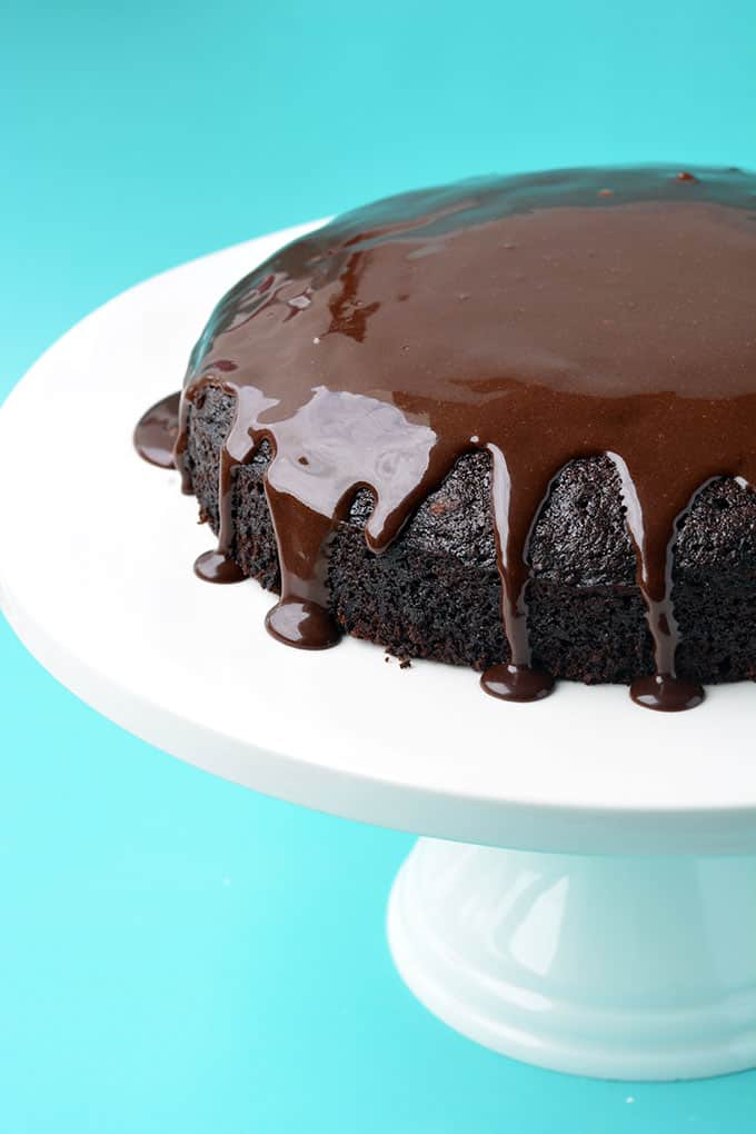 Eggless Chocolate Cake covered in drippy chocolate ganache