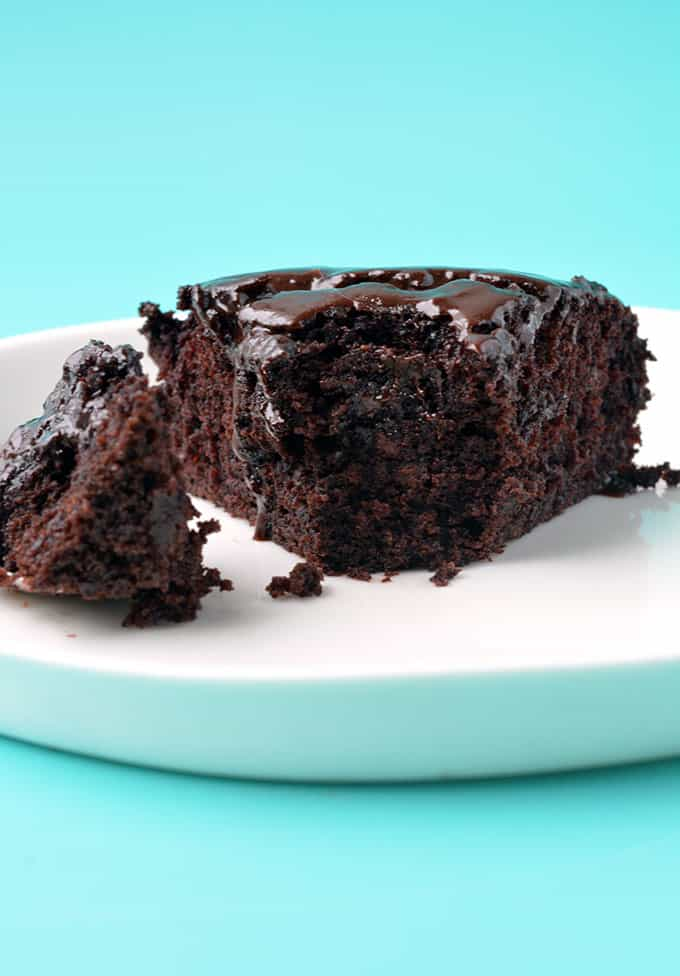 A slice of Eggless Chocolate Cake with a bite taken out of it