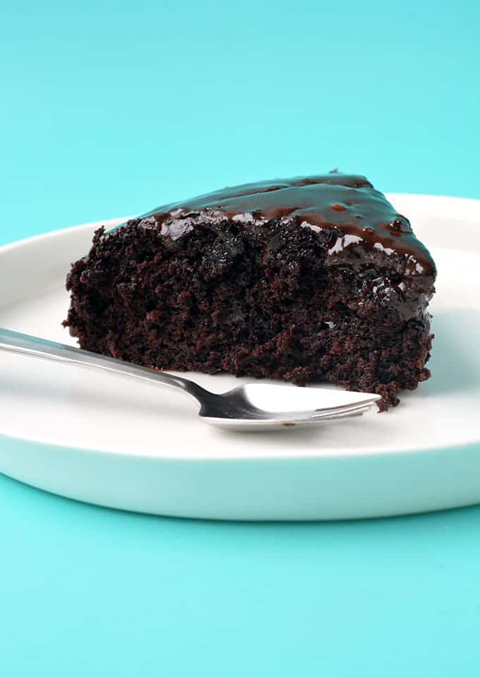 A close up of a slice of Eggless Chocolate Cake