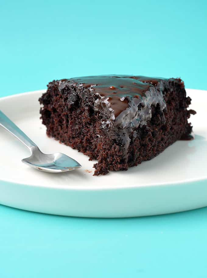 A slice of Eggless Chocolate Cake on a white plate
