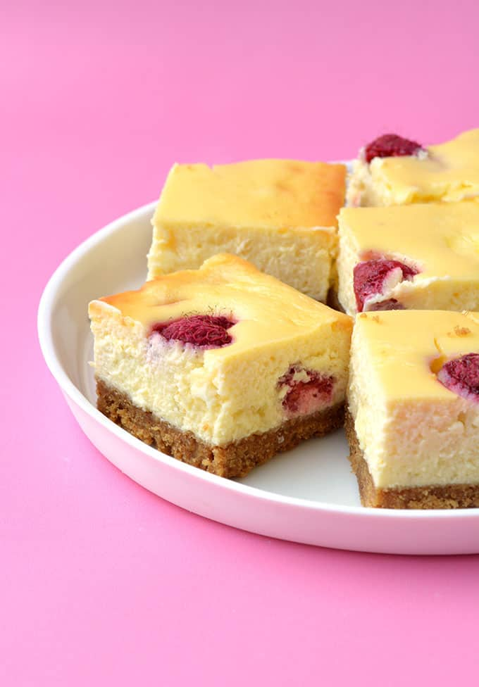 White Chocolate Raspberry Cheesecakes on a white plate