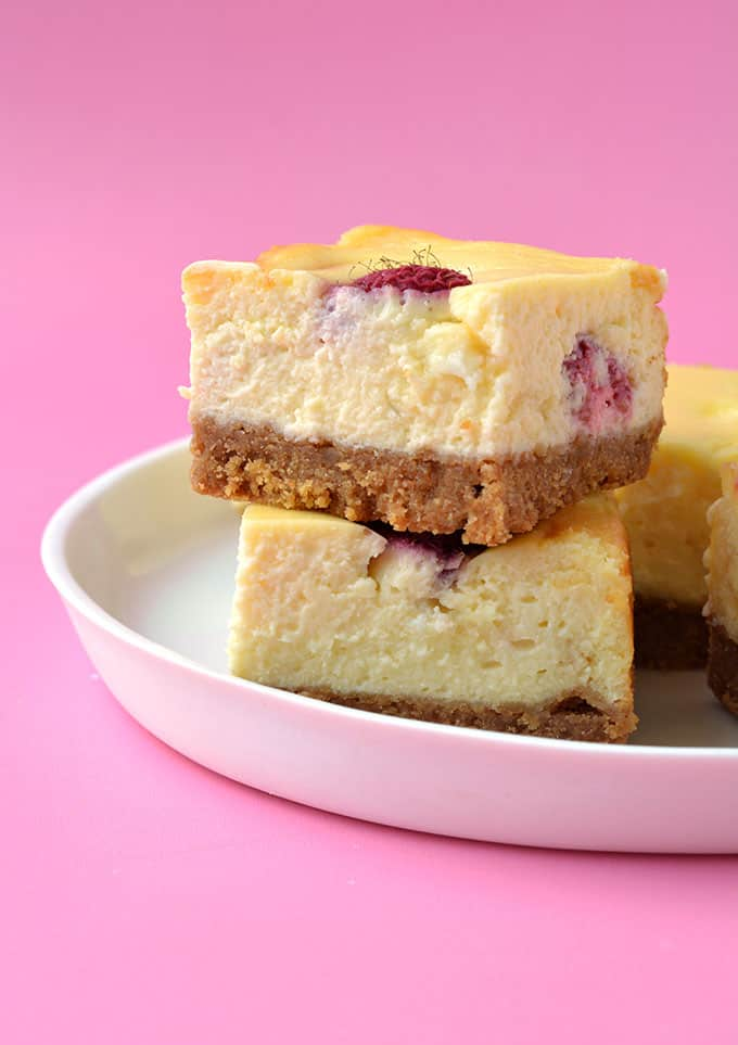 Baked White Chocolate Raspberry Cheesecake on a white plate