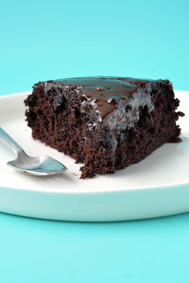 A piece of chocolate cake on a blue background