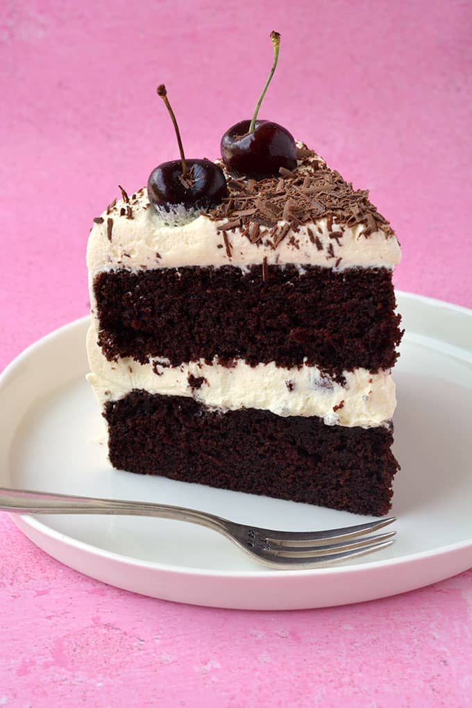 A slice of Black Forest Cake on a white plate