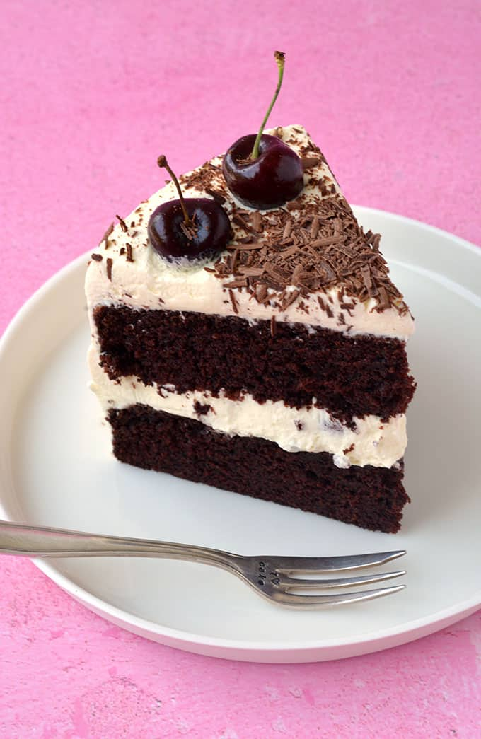 A piece of Black Forest Cake on a white plate