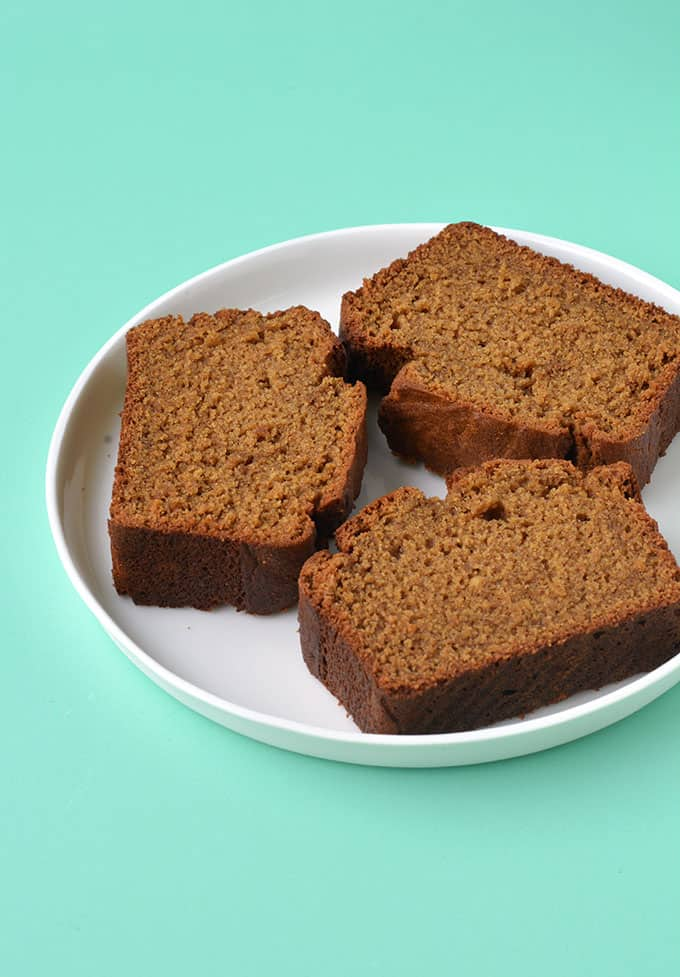 Thick cut slices of Gingerbread Loaf on a white plate