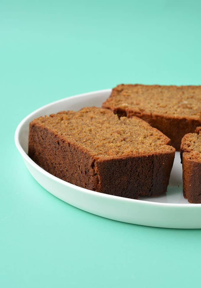 A piece of Gingerbread Loaf Cake on a white plate