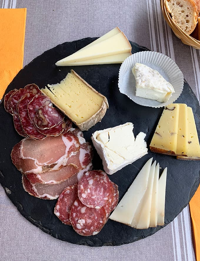 A plate of cheeses and salami