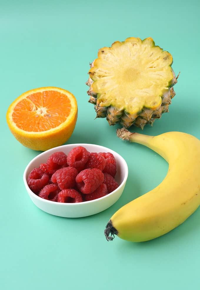 A selection of fruit on a green background
