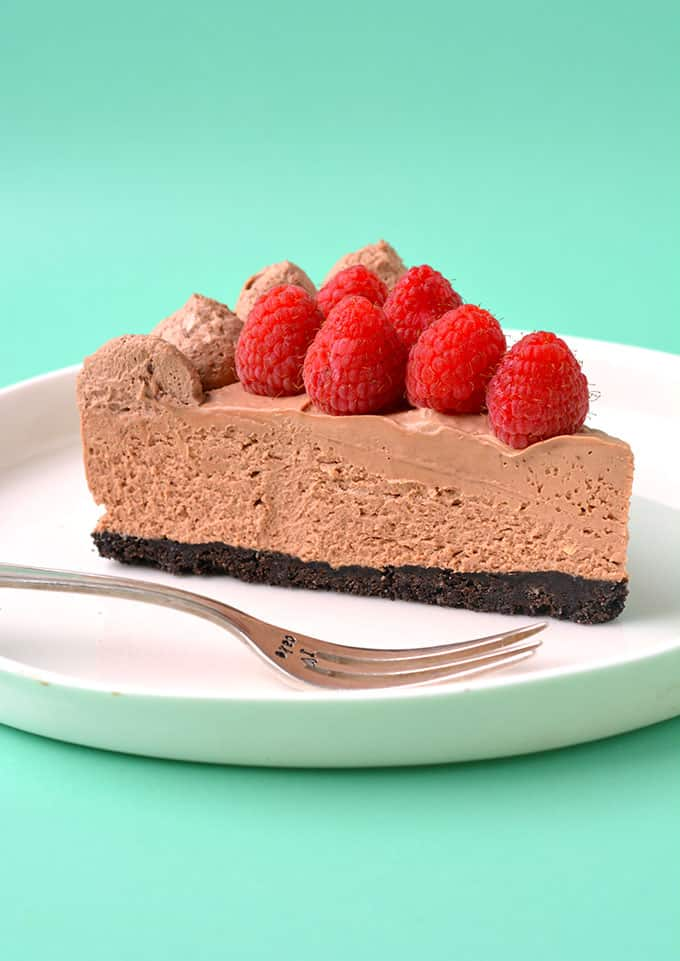 A close up of a slice of Raspberry Chocolate Cheesecake