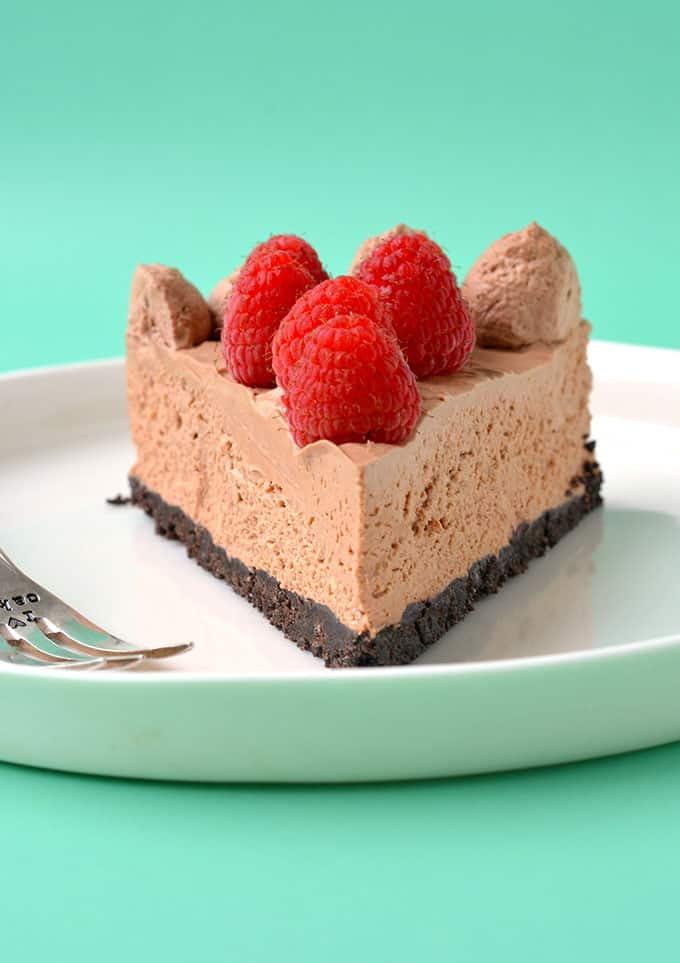 A close up of a Chocolate Cheesecake on a white plate