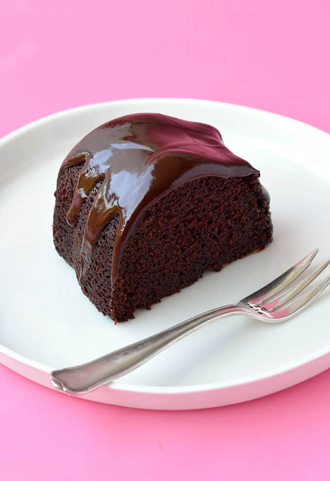 A slice of chocolate bundt cake on a white plate