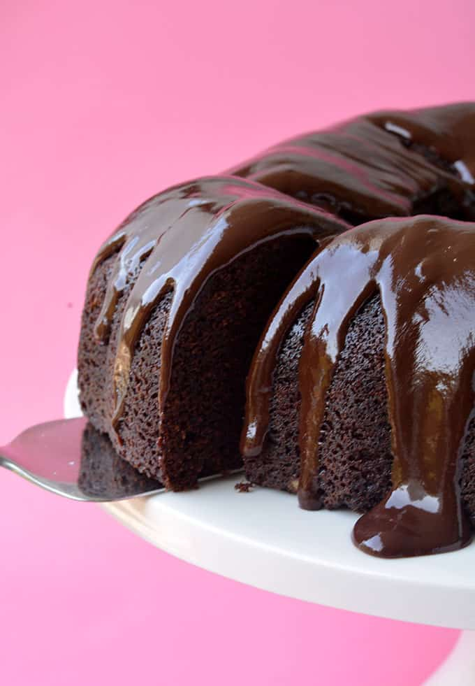 A close up of a Chocolate Bundt Cake with a slice cut out
