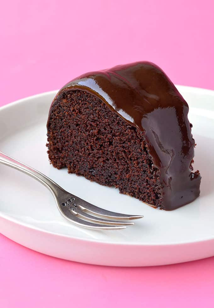 A slice of Chocolate Sour Cream Bundt Cake on a white plate