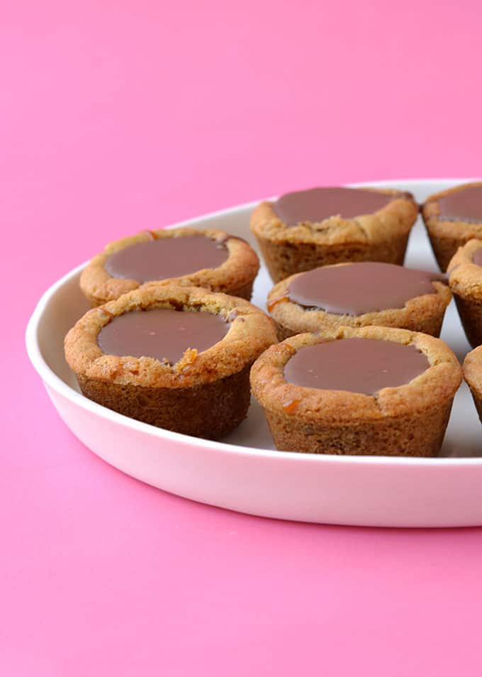 A plate of Homemade Twix Cookie Cups on a white plate