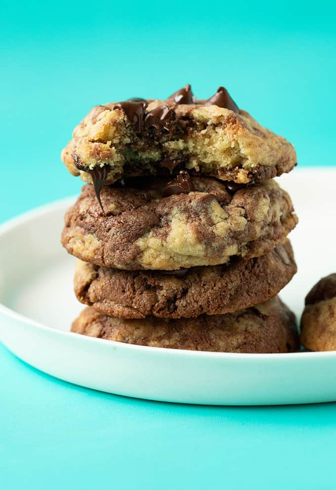 A stack of Nutella Cookies with a bite taken out of it