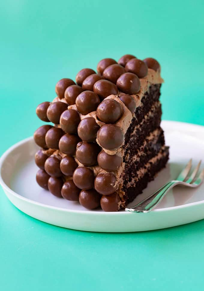 A big slice of Malteser Cake on a white plate