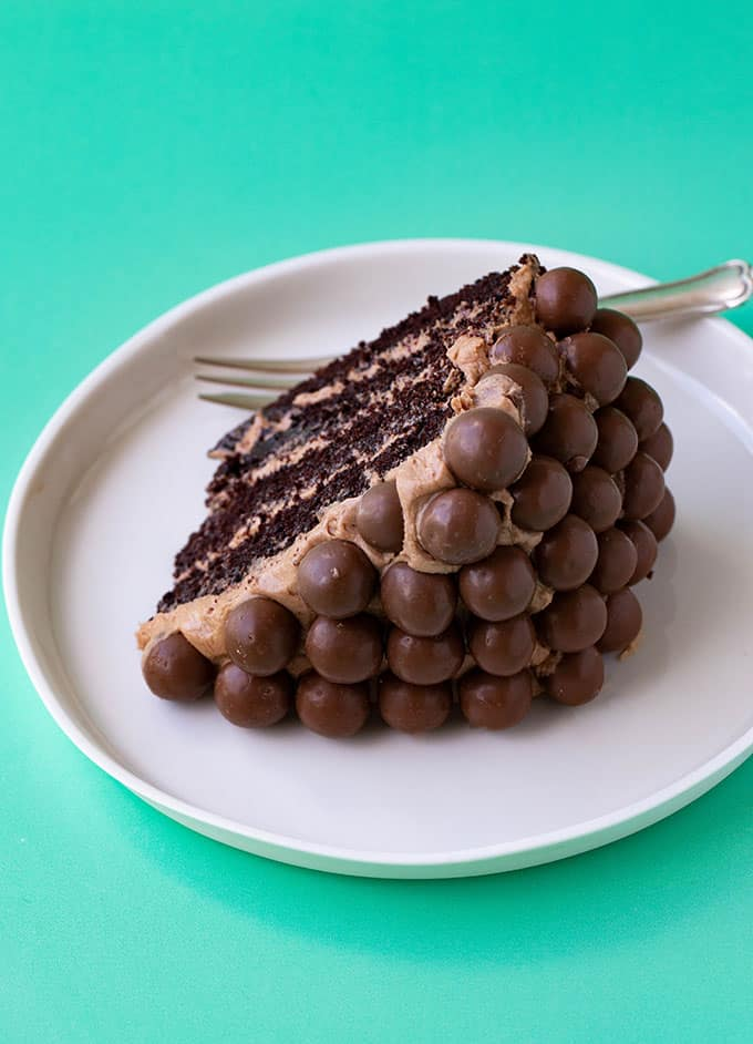 A slice of Malteser Cake on a white plate
