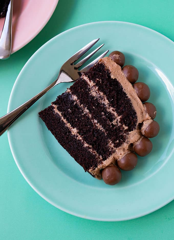 A close-up view of a slice of chocolate layer cake