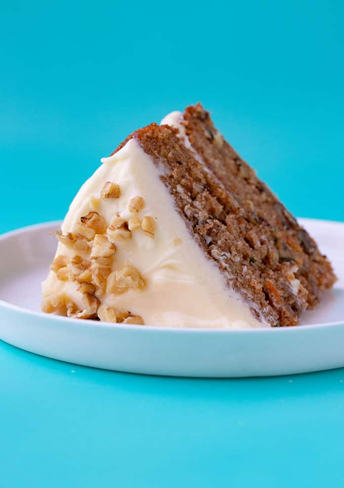 A piece of Carrot Cake lying down on a white plate