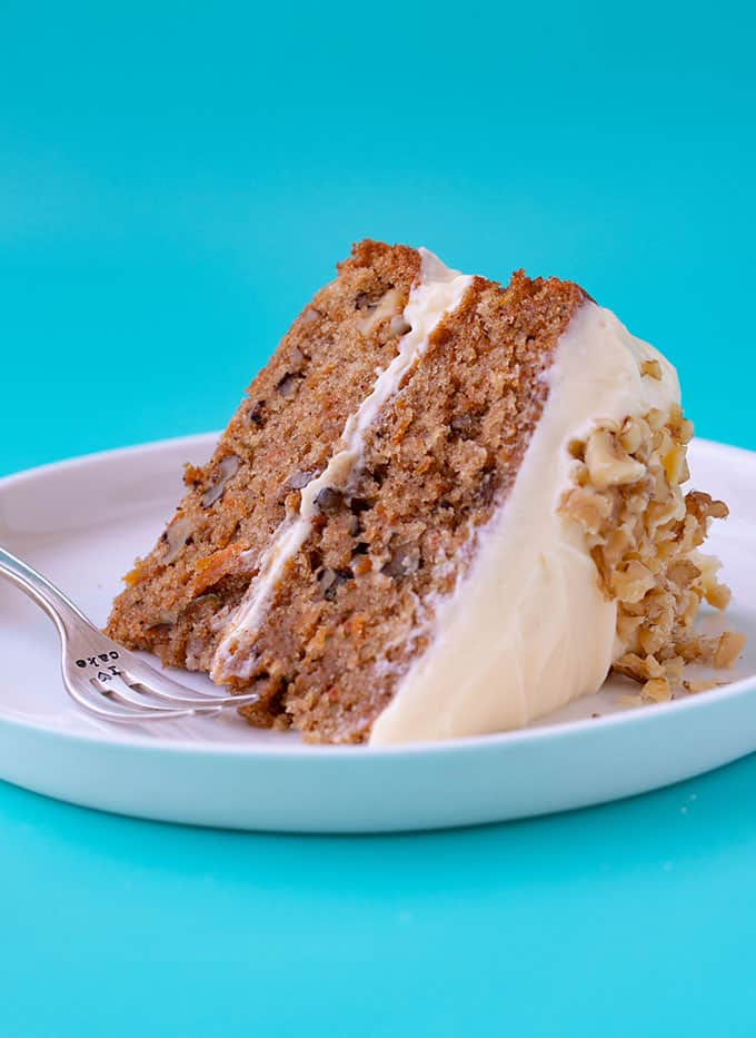 A slice of Carrot Cake on a blue background