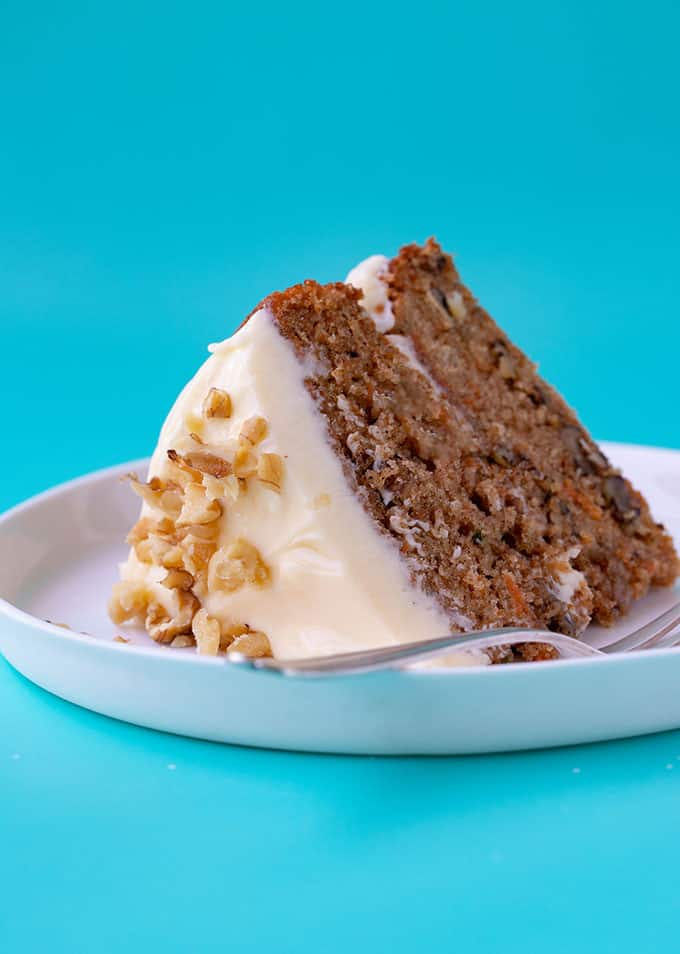 A piece of homemade Carrot Cake on a white plate
