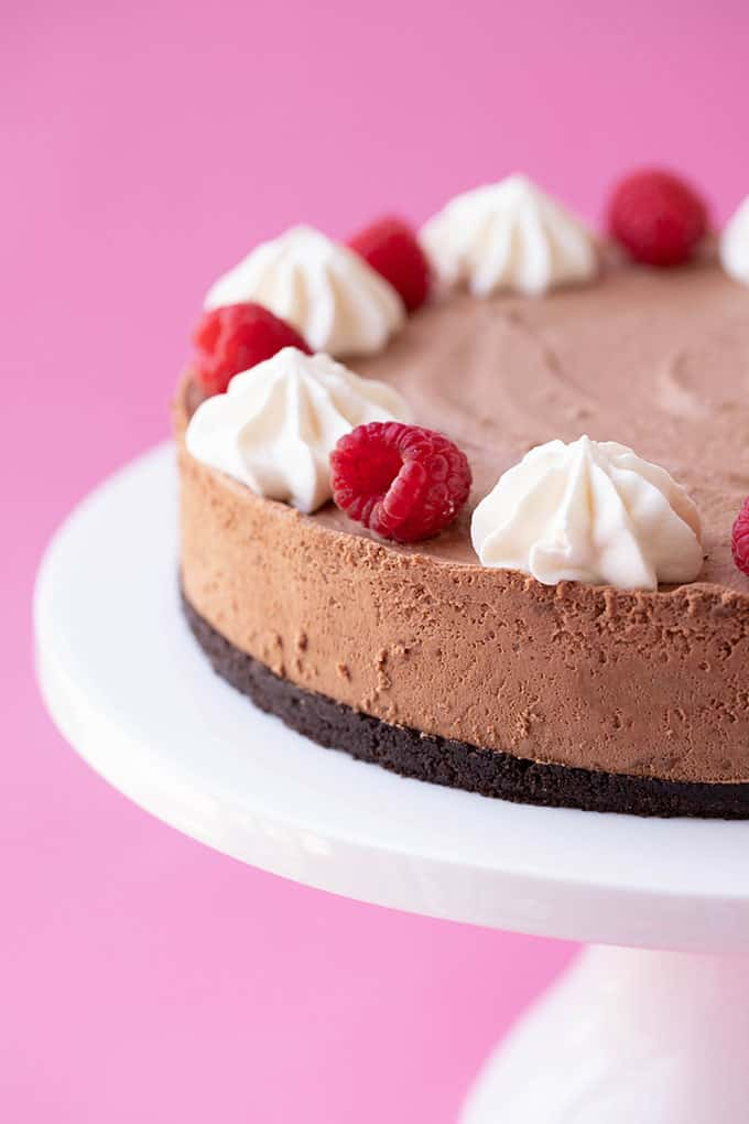 Chocolate mousse cake on a white cake stand