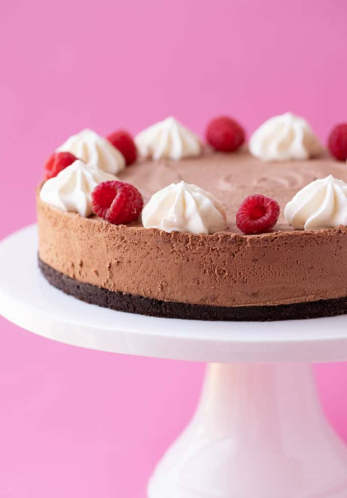 A beautiful Chocolate Mousse Cake on a white cake stand