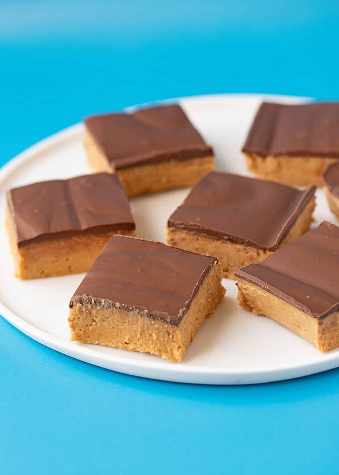No bake peanut butter bars on a white plate