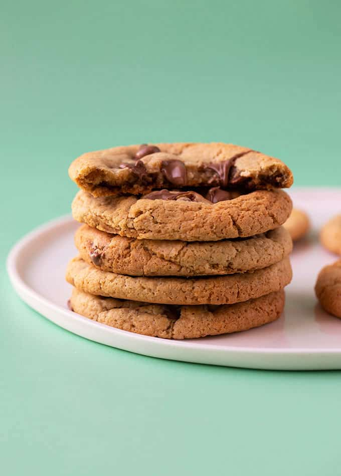 A stack of gluten free chocolate chip cookies on a white plate